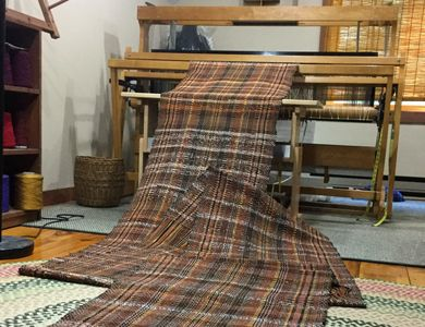 Woven rag rugs and pillow covers off the loom