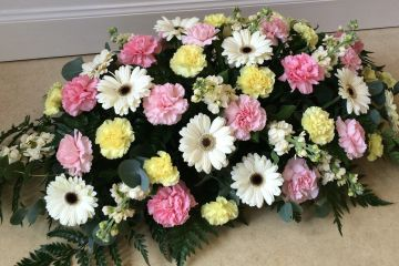 Carnation and Gerbera Coffin spray. Telephone for colour and size advise. 01294 322768