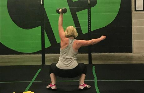 woman dumbbell snatching
