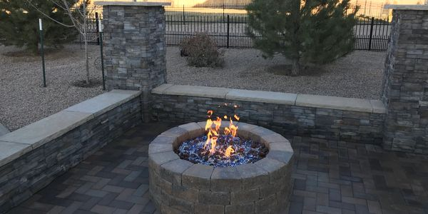 Paver patio, veneer columns, gas lanterns and fire pit in Grand Junction, CO