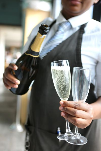 waiter pouring glass of champagne