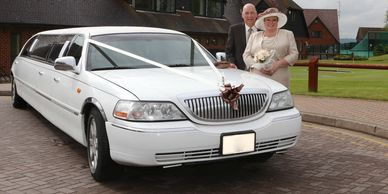stretch Limo with couple behind it