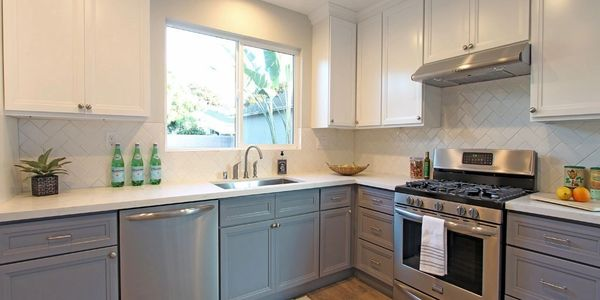 grey double shaker and white upper cabinets with quartz counter top subway backsplash on sale