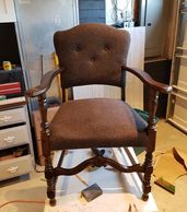 This chair was in the family for several generations. It was stained, repaired, reupholstered.