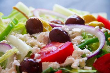 mediterranean salad iceberg romaine lettuce tomatoes red onions peppers Kalamata philly pizza grill