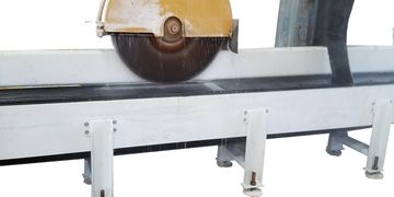 Heavy Duty Belt Conveyor Under a bridge saw by Endurance Engineering and Manufacturing.