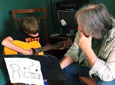 GUITAR STUDENT with GUITAR TEACHER during MUSIC LESSON at SMITHVILLE MUSIC STUDIO