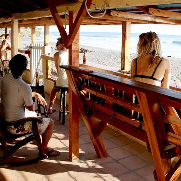 social hour on the terrace starts every morning with a surf check and strong coffee.
