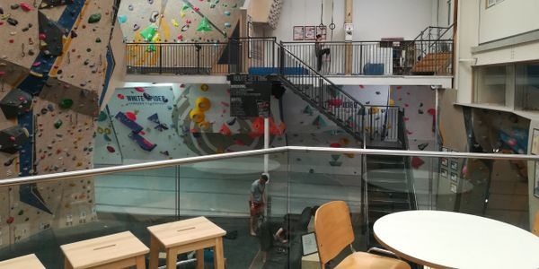 Mezzanine floors for climbing, viewing, cafeteria and office space at an indoor climbing centre.