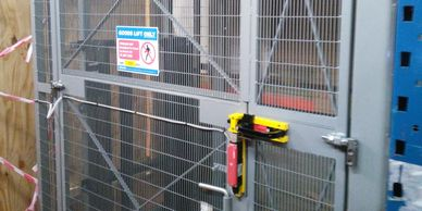The interlocked gate of a mezzanine goods lift at a West London site.