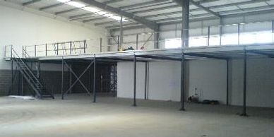 A storage mezzanine floor with access staircase and industrial double tubular handrail in Middlesex.