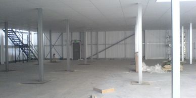Fire protective suspended ceiling under a mezzanine floor in a South London distribution warehouse.