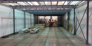 An office mezzanine floor with a large clear span being assembled inside a coldstore in Surrey.