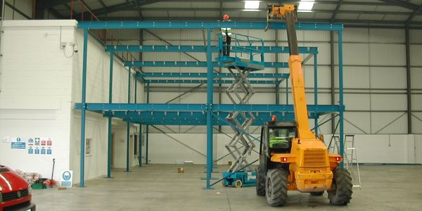 Two storey mezzanine floor creating offices for an automotive recovery and repair company in London.