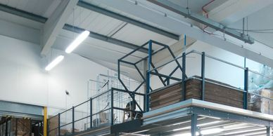 An up and over pallet safety gate on a storage mezzanine at a London distribution centre.