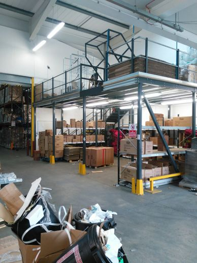 A small mezzanine floor above a despatch area  for storage of packaging in London.