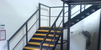 A twin flight steel staircase with quarter turn landing and handrail in Kent.