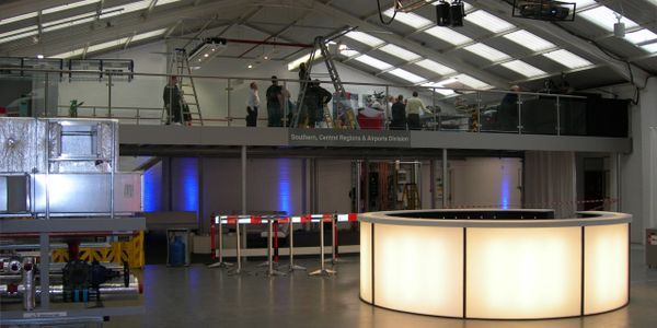 Trade showroom mezzanine floor with stainless steel and glass handrail near Heathrow.