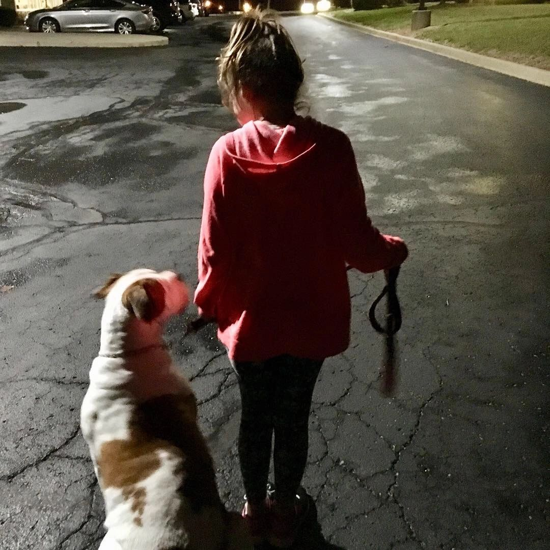 8 year old, Alyssa, handles her 107 pound American Bulldog, Rose, with confidence.