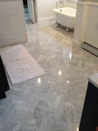 Marble bathroom remodel herringbone floor