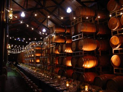 Uplighting & string lighting, wedding reception, The Barrel Room, at Firestone Winery, Santa Ynez.