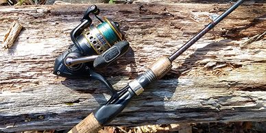 Penn Battle II Fishing Reel on a Shakespeare Ugly Stik Elite, Pictures on a Weathered Log