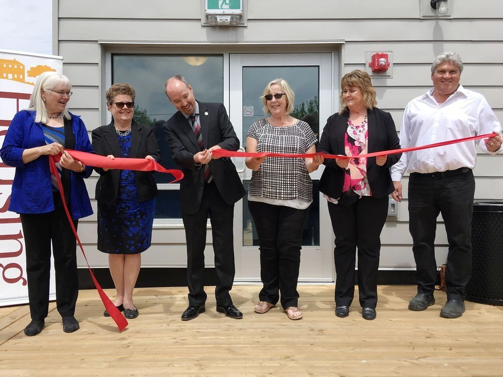 Mayor Bryan Paterson cuts a ribbon at KFHC's new 29-unit affordable housing building on Brock Street