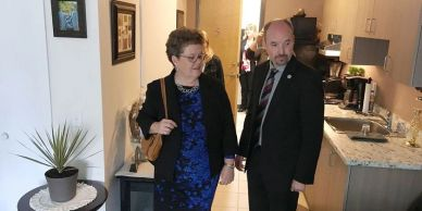 KFHC's Board Chair Denise Cummings and Mayor Bryan Paterson view a bachelor apartment at 645 Brock.