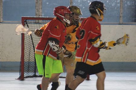 Box lacrosse offense versus one defender