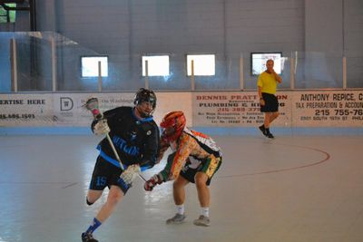 Box Lacrosse player going around a defender