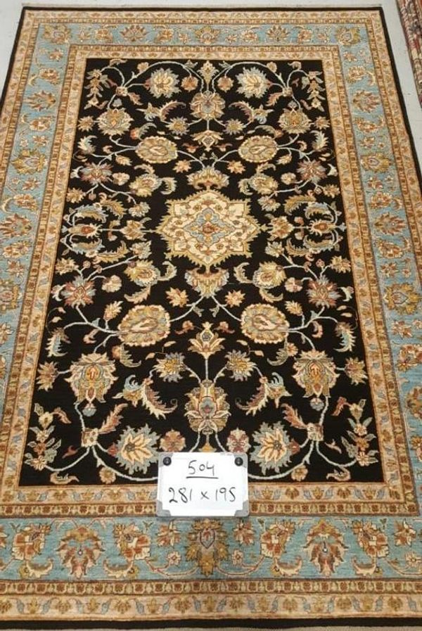 Afghan fine quality wool handmade hand knotted rug. Colors black, gold and blue natural dyes.