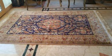 Luxury hand knotted fine quality Qom silk Persian carpet.