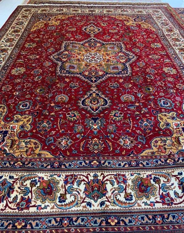 Beautiful Tabriz Iranian handmade carpet size 300 x 400 cms. Red with central medallion and border.