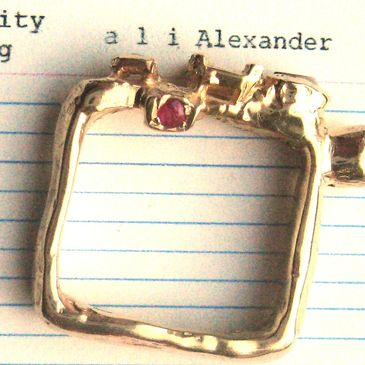 Square gold ring with a missing stone, ruby, coprolite and diamond