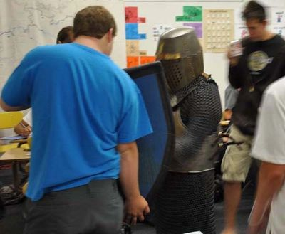 Students try on armor
