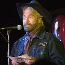 Michael Martin Murphey announces an award recipient during the Texas Music Awards red carpet event.