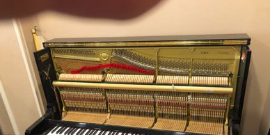 Piano being prepared for tuning by Sydneu Piano Tuning