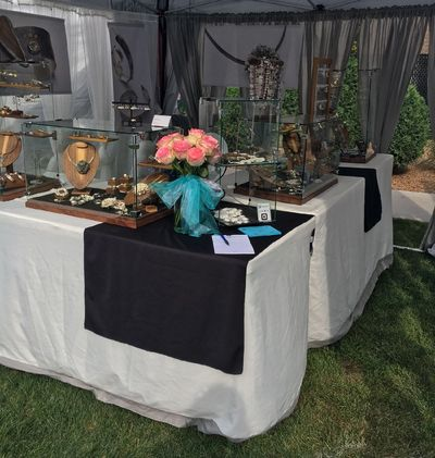 Girl Meets Joy Jewelry outdoor booth at fine art festivals and shows.