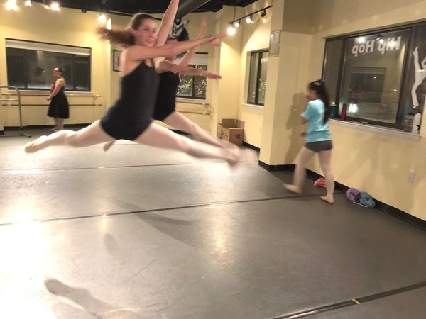 Ballet dancers leaping at All That Jazz