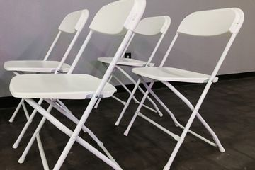 White folding chairs make an impression on your guests when they match your decorations at your part