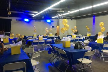 A birthday party using our blue lighting with blue table cloths.