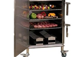 SmokinTex Model 1500 with food. Showing two chip boxes and superior stainless steel construction.