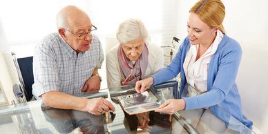 nursuring woman with two older people looking at the photos