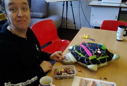 A volunteer creating an item in our Creating For Charity workshop.