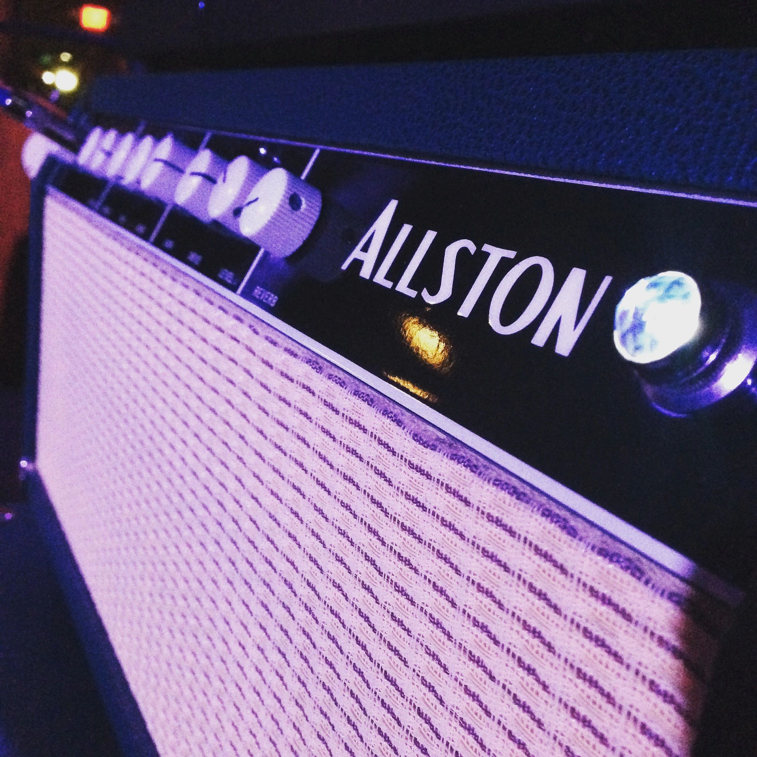 Perspective view of Sam's Allston AOC mark 1 head under blue stage lighting.