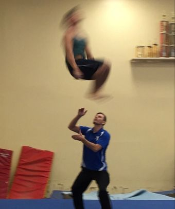 Private lessons with coach Deyan at Gymnastics Palace. Double back tuck flip on floor with spot.