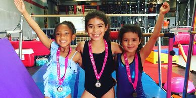 Girls Beginner Class at Gymnastics Palace. Medals. Uneven Bars, Floor, Vault, Balance Beam.