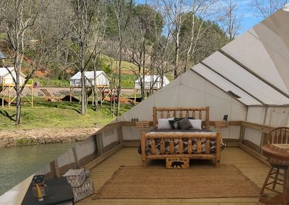 Rusty's roost river camp along the north toe river in green mountain NC. Rental Camping in NC.