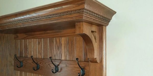 Custom made mudroom bench to match early 1900 trim work on inside of historical remodel