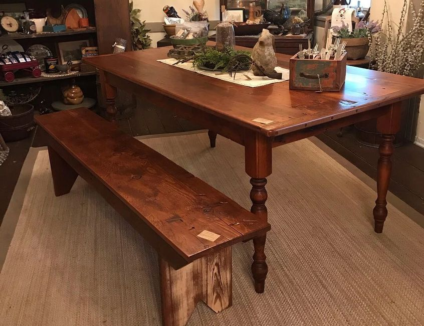 Handcrafted reclaimed barn wood table with turned legs.  Reclaimed barn wood bench.